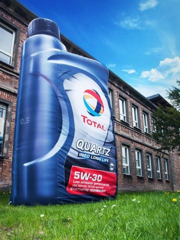 A bottle of Total Quartz motor oil