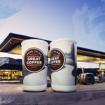 Unusual advertising balloons in the shape of a coffee cup