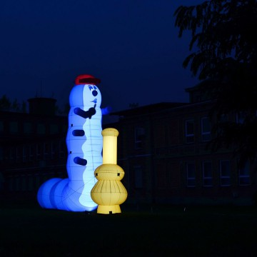 Inflatable caterpillar with internal LED lighting.